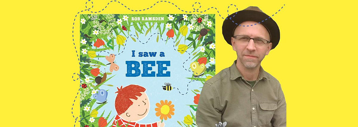 Cartoon drawing of a boy and a bee, next to the author in a wide brimmed hat and green shirt